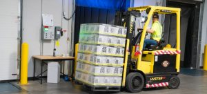 Forklift lifting cargo