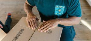 Man preparing for shipping medical equipment
