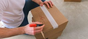 Person labeling boxes