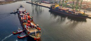 Two ships with containers getting ready to sail